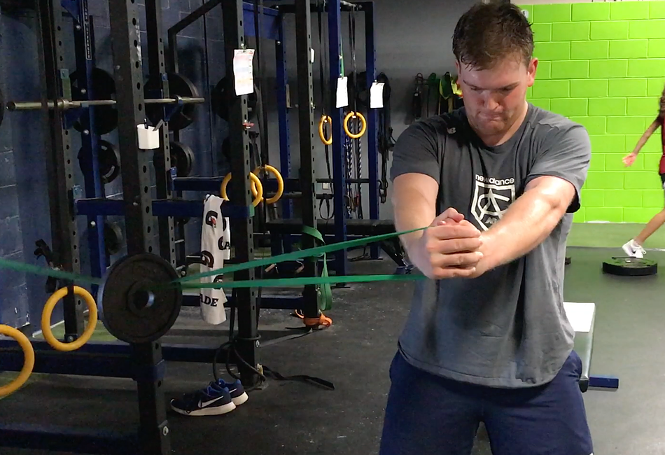 Core Training: The Pallof Press with Weighted Perturbation
